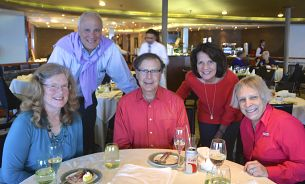Many of Larry's Club Hosts also Cruise with him. Here he is with Peter and Karen Warshaw. (Standing)