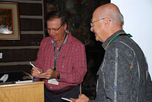 Larry autographing a book.