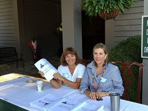 Page Powell and Ginny Moore welcoming everyone as they arrived at the Lake Toxaway CC